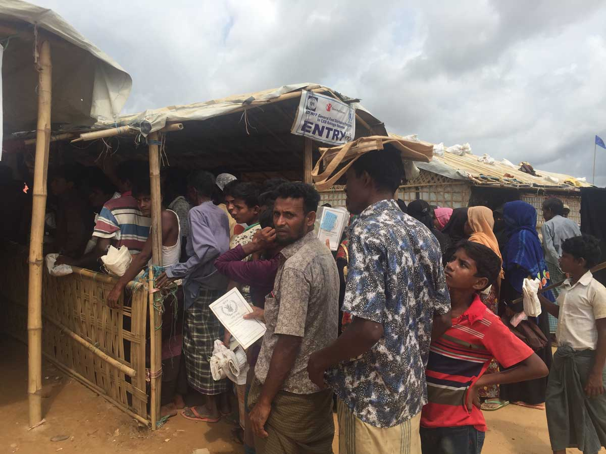 Lining up for food distribution on a daily basis.